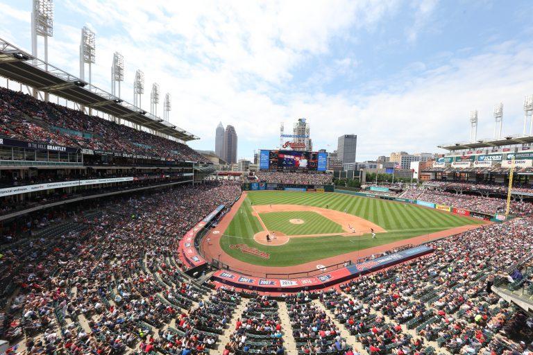 Photo of stadium and city skyline of Cleveland, Ohio.