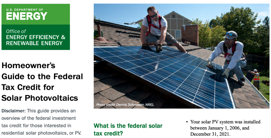 A screenshot of the Department of Energy's PDF on Federal Solar Tax Credits showing two men installing a solar panel on the roof.