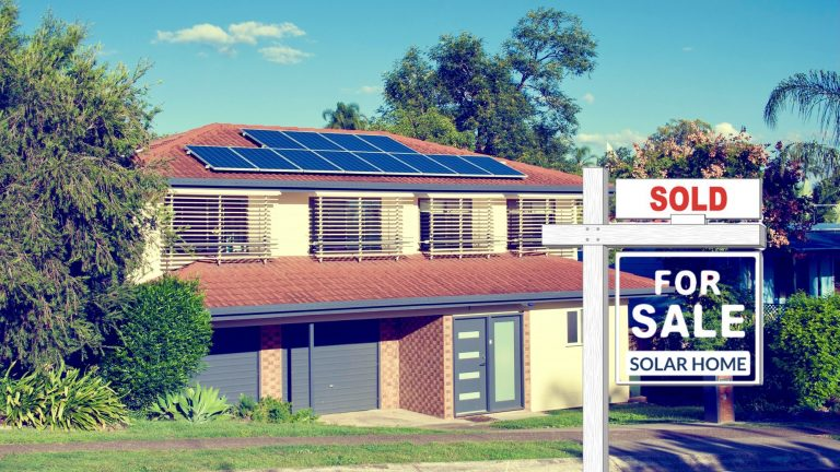 "A picture of a modern California home with solar panels on top and a for sale sign out front that says ""Solar Home"""