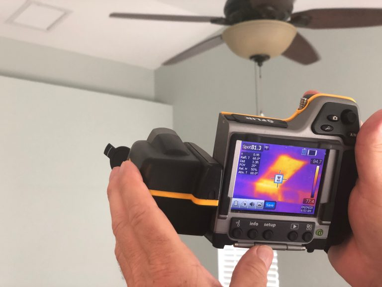 infrared camera showing heat coming from the HVAC during the blower door test of our net-zero project
