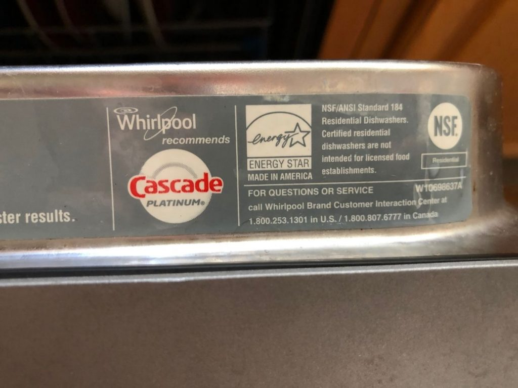 Closeup photo of Energy Star label certifying energy efficiency on a dishwasher