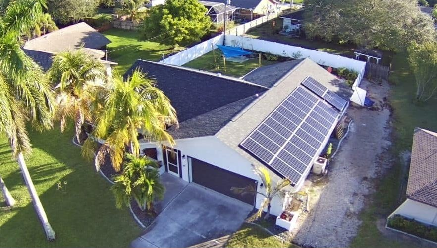 aerial view of net-zero house with solar panels on the roof