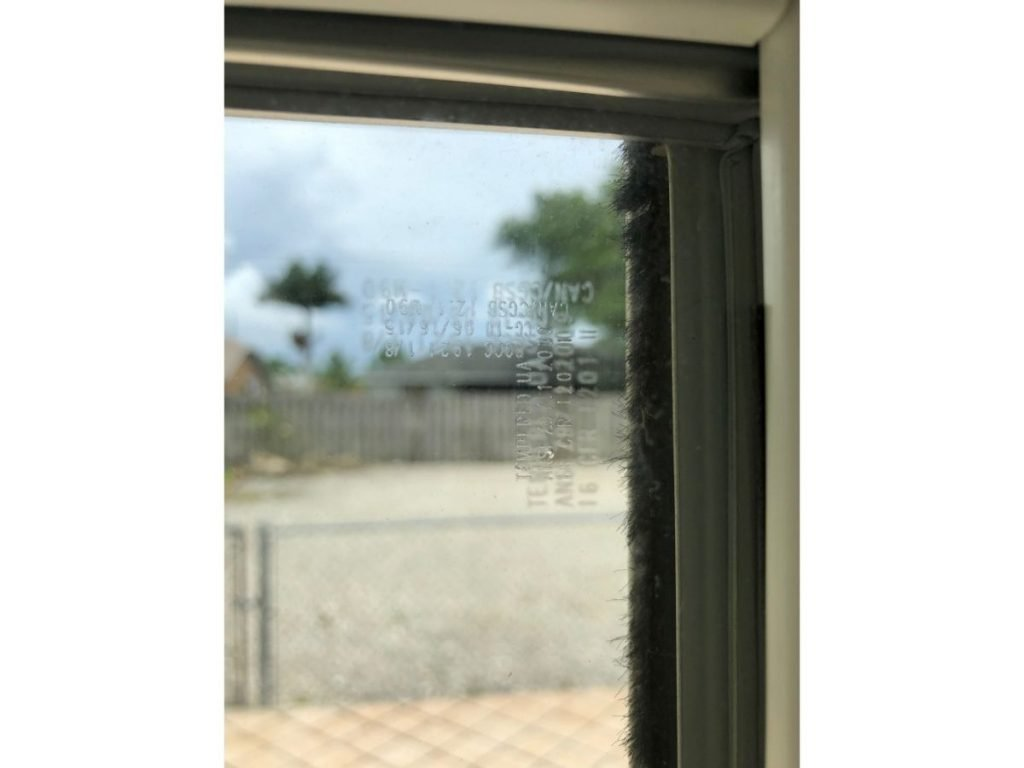 Closeup of the corner of a window showing the weather stripping