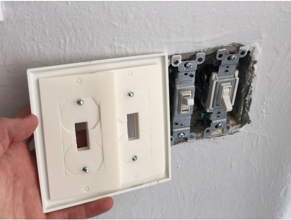 Photo image of light switch plate gasket for air sealing