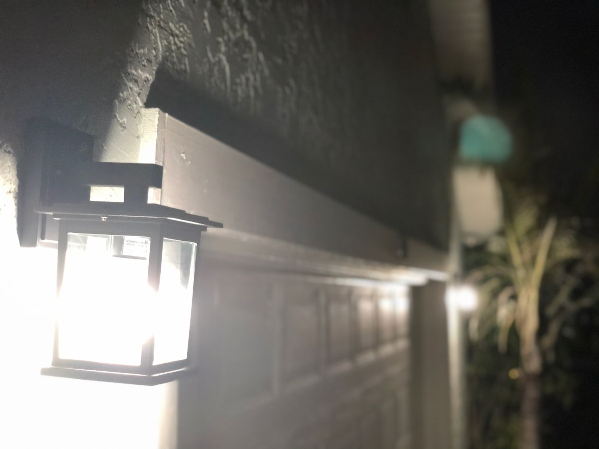 Photo of energy efficient outdoor lighting fixture at night from the First Attainable Home project.