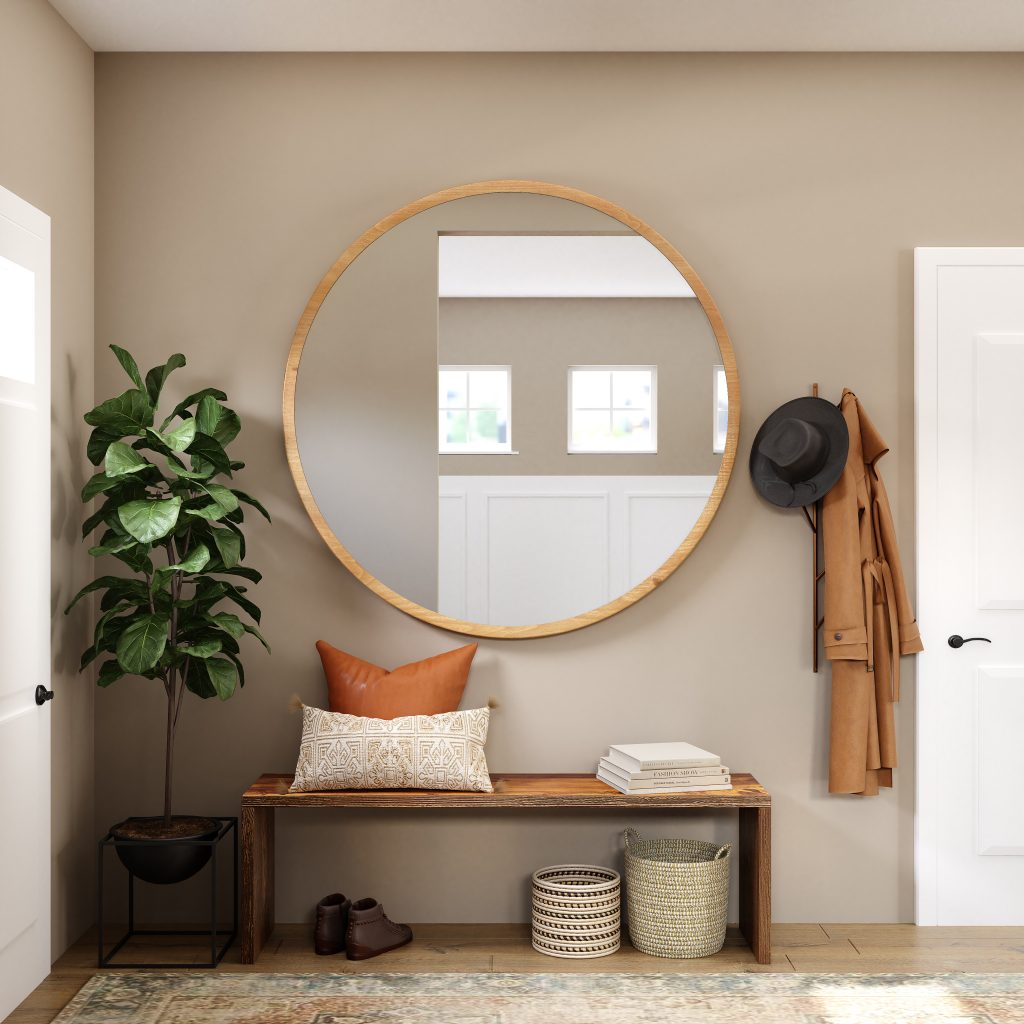 Photo of a mirror in a brightly lit entry, making the space appear larger.