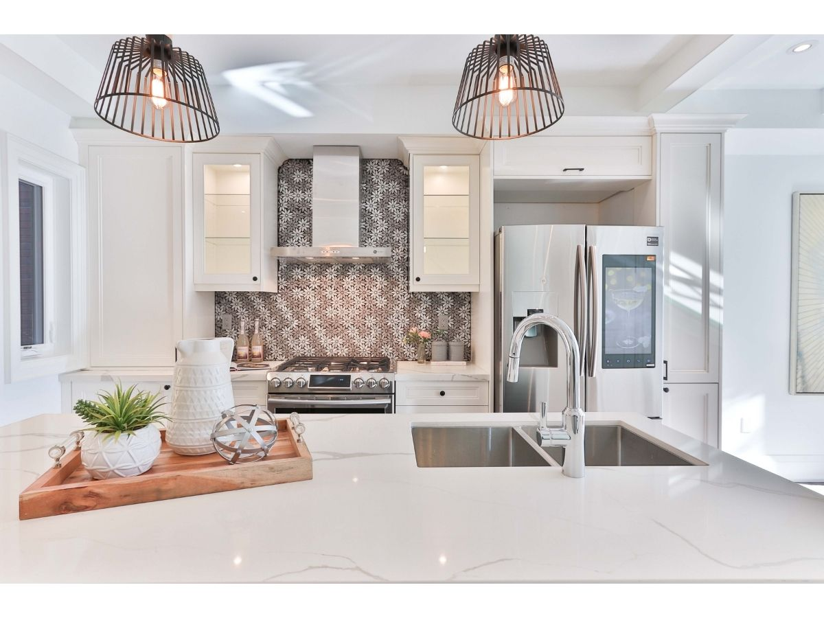 Photo of a brightly lit, modern kitchen in a new, energy-efficient house.