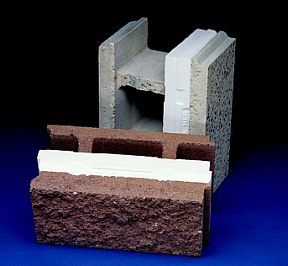 Specially designed KORFIL Hi-R concrete masonry units with molded insulation inserts and a decorative face for energy-efficient wall construction.