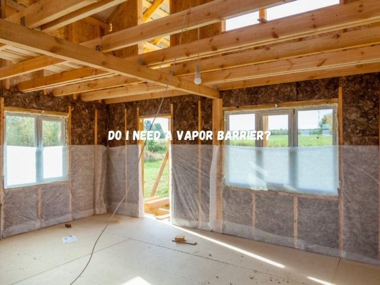 """Photo of the interior of a home under construction with exposed insulation partly covered by a vapor barrier and the caption """"Do I need a vapor barrier?"""""""