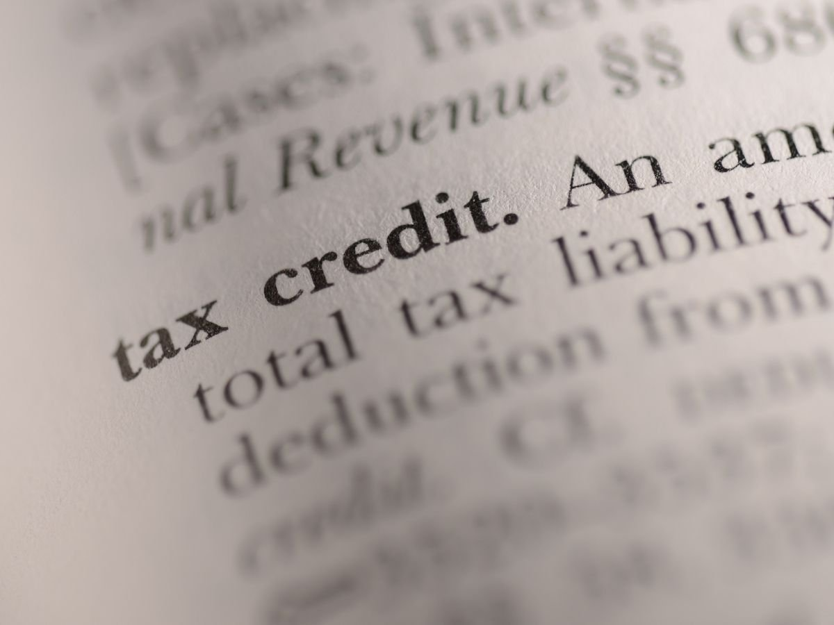 """Closeup photo of a page of print with the words """"tax credit"""" highlighted"""