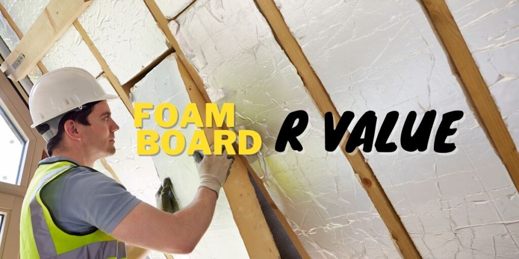a man in a hardhat and yellow safety vest installing rigid foam board insulation in the wall.
