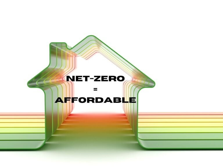 """Photo of a house shape fashioned out of bands of green, yellow and red plastic that look like the HERS rating table with the caption """"Net-zero=affordable"""" because net-zero homes are affordable to build."""